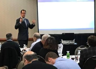 Dan Schulte presents on new opioid prescribing laws to physicians at Blue Cross Blue Shield of Michigan quarterly PGIP meeting