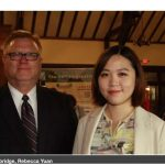 Image of Jim Cambridge and Rebecca Yuan during the Chinese Business International Golf Outing